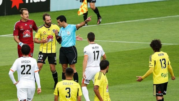 Controversial: referee Stephen Lucas after reversing his decision to award a penalty to Brisbane.