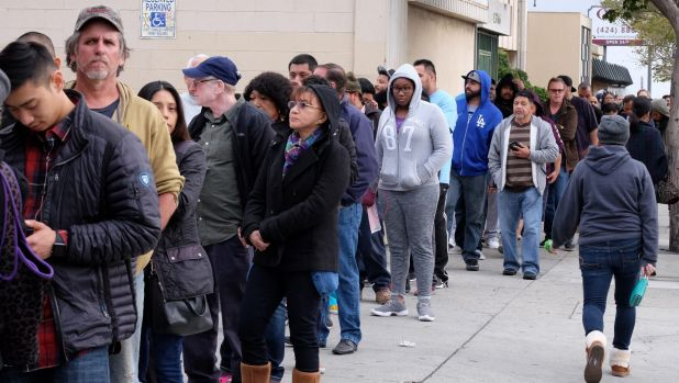 Customers wait in line at the Blue Bird Liquor Store to buy Powerball lottery tickets in Hawthorne, California.
