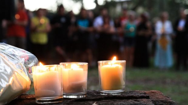 Community members farewell Queenie Xu at a candelight vigil across the road from her Parkinson home where her ...