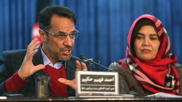 Ahmad Fahim Hakim, left, a member of the Afghan People's Dialogue on Peace Initiative, addresses a press conference in ...