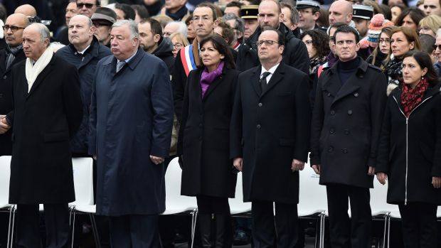 French dignitaries, including Paris Mayor Anne Hidalgo, French President Francois Hollande and Prime Minister Manuel ...