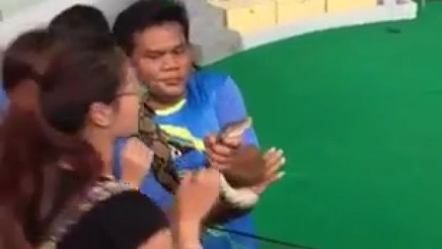 The tourist required stitches after the python bit her on the nose during a snake show.