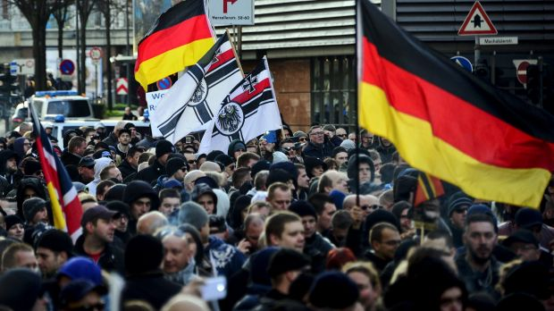 Supporters of  right-wing groups gather in Cologne to protest against the New Year's Eve sex attacks.