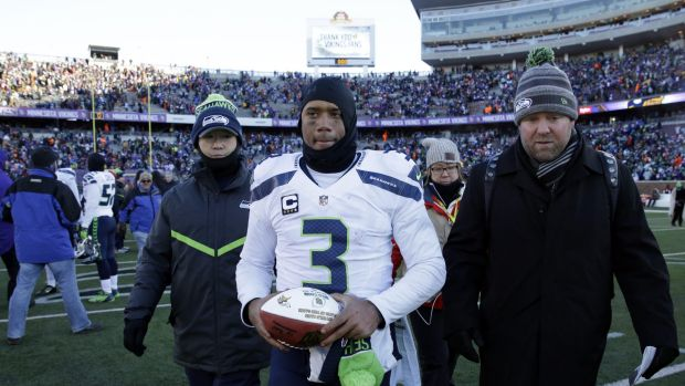Freezing conditions: Seattle quarterback Russell Wilson leaves the field after the win in Minneapolis.