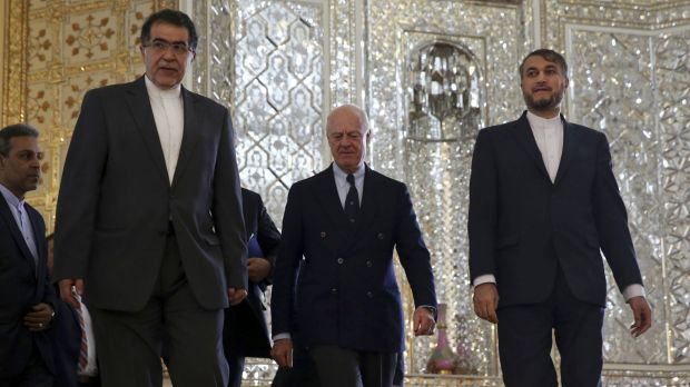 UN Special Envoy for Syria, Staffan de Mistura, centre, arrives for a meeting with Iranian Foreign Minister Mohammad ...