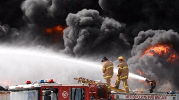 Firefighters struggle to control a tyre fire in Broadmeadows, Melbourne.