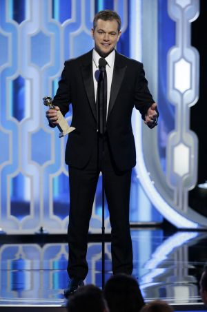 Matt Damon accepts the award for best actor in a motion picture comedy for The Martian.