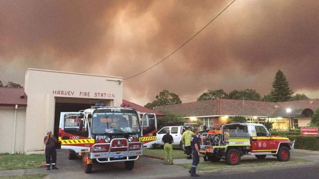 Weary firefighters at Harvey Fire Station in Western Australia on Monday.