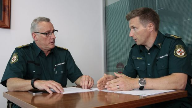The acting chief officer of the ACT Ambulance Service, Jon Quiggin, left, attends a briefing on the extreme heat plan ...
