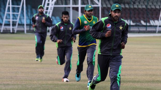 Mohammad Amir, right, takes part in a training camp with other players in Lahore.