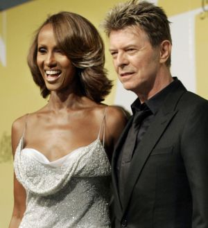A 2005 file photo showing singer David Bowie and his then wife Iman.