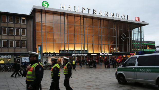 German police patrol in front of the central railway station in Cologne, where retaliatory attacks on immigrants have ...