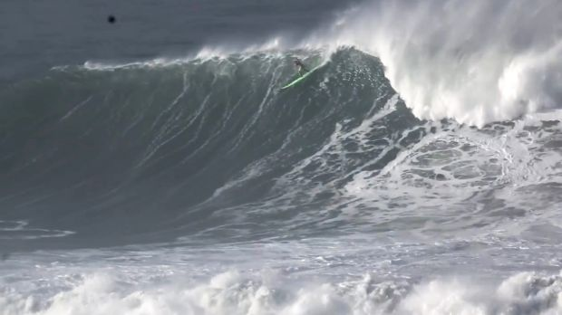 Garrett McNamara takes off on the monster wave.