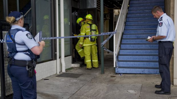 Fire crews and police investigate the alleged arson at the Brierly Street cafe in Weston in March 2014.