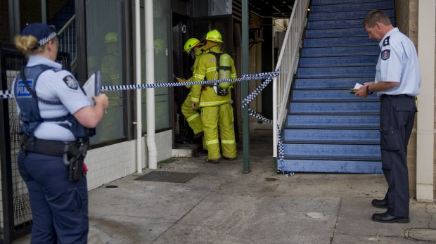 Fire crews and police investigate the fire at the Brierly Street cafe in Weston in March 2014.