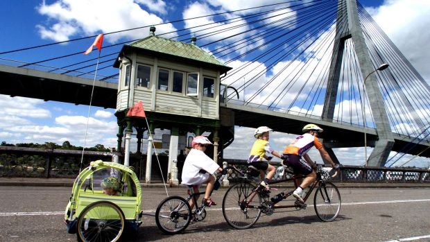 A family crosses the Glebe Island Bridge during a charity ride in 2000.