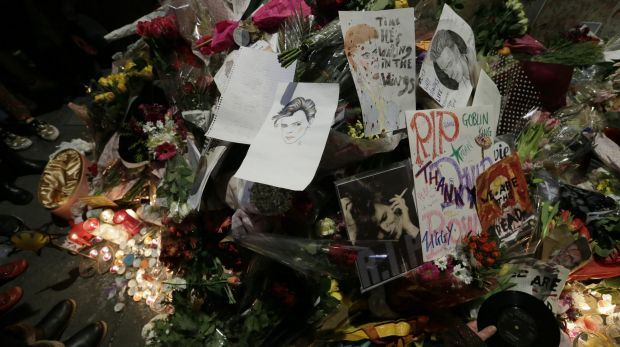Floral tributes are placed near a mural of British singer David Bowie in Brixton, south London.