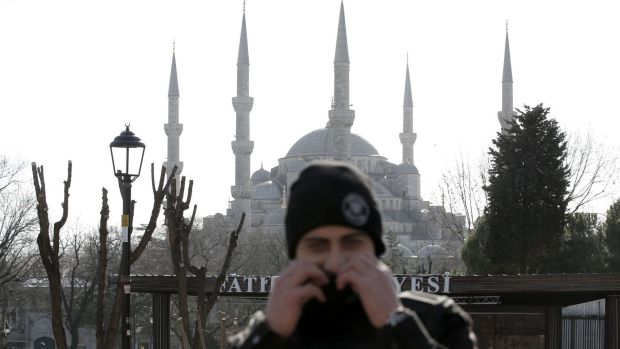 A policeman stands in front of the Blue Mosque in the historic Sultanahmet district after the explosion.
