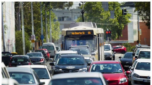 A tram is stuck in traffic between Alexandra Parade and Queens Pde on Smith St.
