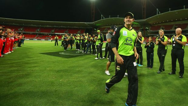 Michael Hussey is given a guard of honour as he leaves the field after Monday night's loss to the Renegades.