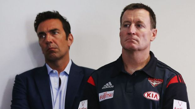 Essendon coach John Worsfold listens to a press conference at the club on Tuesday.