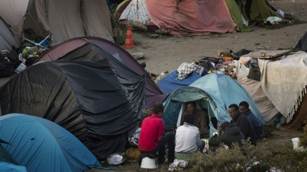 Migrants at their camp set near Calais, northern France.