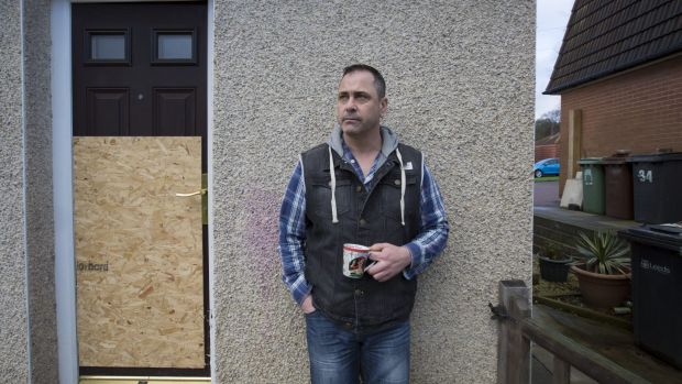 Former British soldier Rob Lawrie stands outside his house in Guiseley, England.