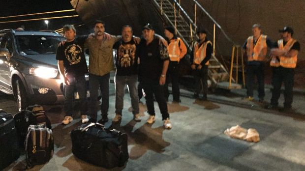 Crew members of the MV Portland on the wharf after being removed from their ship in the early hours of Wednesday morning.