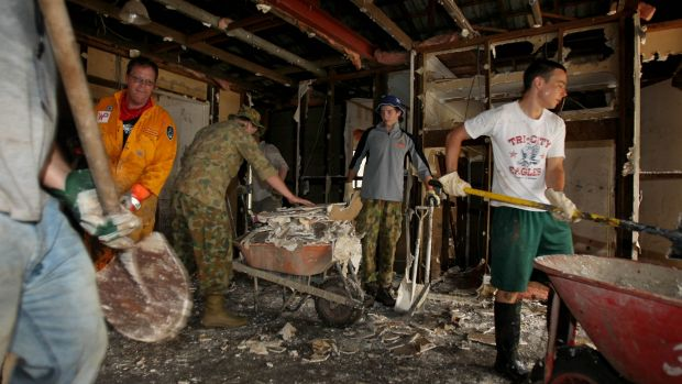 Members of the Mud Army clear a flood-affected home in Fig Tree Pocket.
