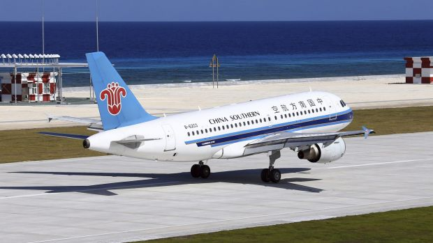 A China Southern Airlines jetliner lands at the airfield on Fiery Cross Reef, known as Yongshu Reef in Chinese, in the ...