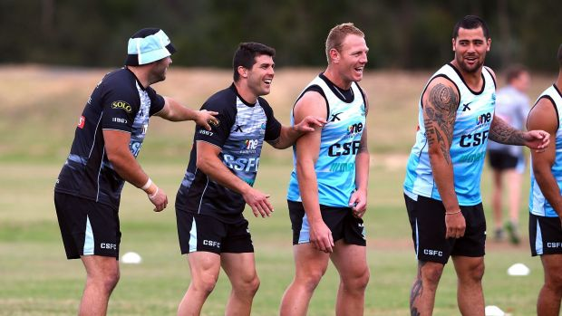 Pre-season training: Wade Graham, Michael Ennis, Luke Lewis and Andrew Fifita joke around during a Cronulla Sharks ...