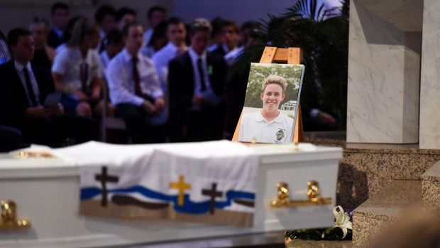 A portrait of 18-year-old one-punch victim Cole Miller is placed near the coffin.