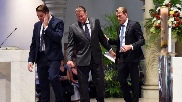 Mitchell, Steven and Billy Miller leave the altar after delivering the eulogy at Cole Miller's funeral service.
