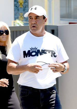 Jeff Fenech reads a statement outside his Five Dock home on Wednesday.