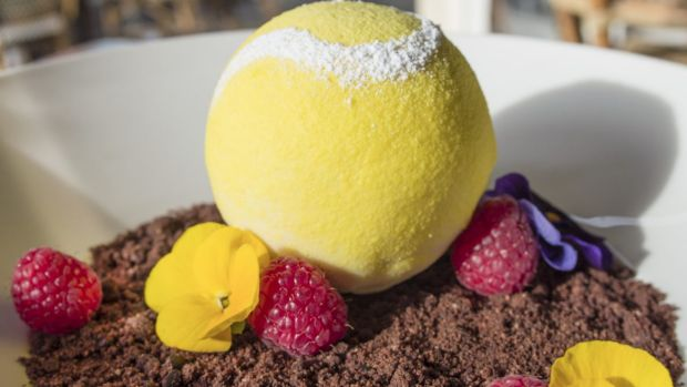 Tennis ball-shaped white chocolate mascarpone with raspberry centre and chocolate soil from Richmond Hill and Larder.