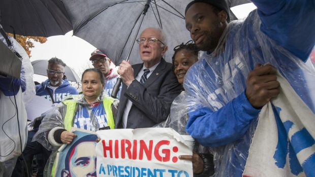 Senator Bernie Sanders joins low-wage workers, some who work as cooks and cleaners at the Capitol, during a rally to ...