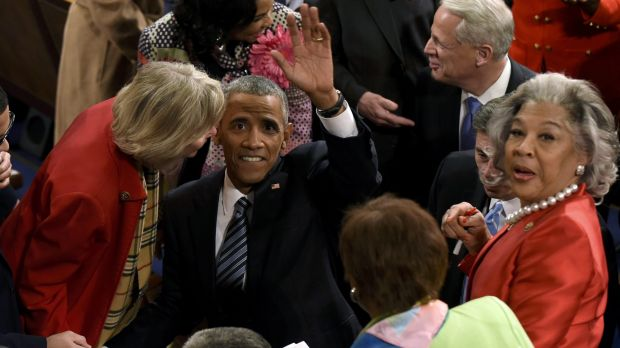 President Barack Obama waves from the House floor after the address.