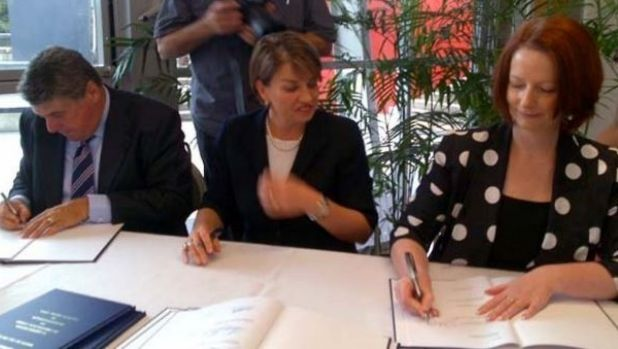 Where the Petrie to Kippa Ring Rail line began in December 2010. Then-prime minister Julia Gillard signs a three-level ...