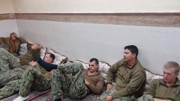 This picture released by the Iranian Revolutionary Guards shows the detained US Navy sailors at an undisclosed location.