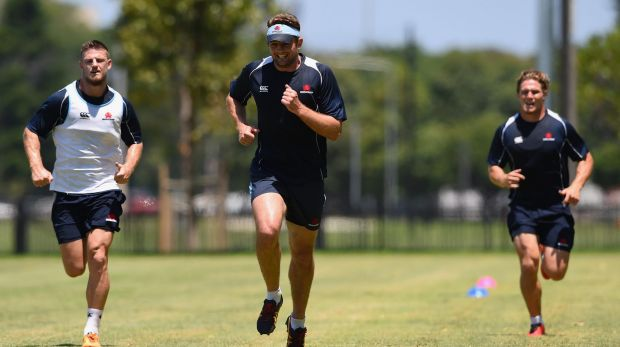 Rob Horne, Dean Mumm and Michael Hooper of the Waratahs during a fitness drill on Wednesday.