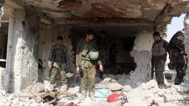 Afghan security forces inspect a building, used by insurgents to launch an attack on Pakistan's consulate in Jalalabad.