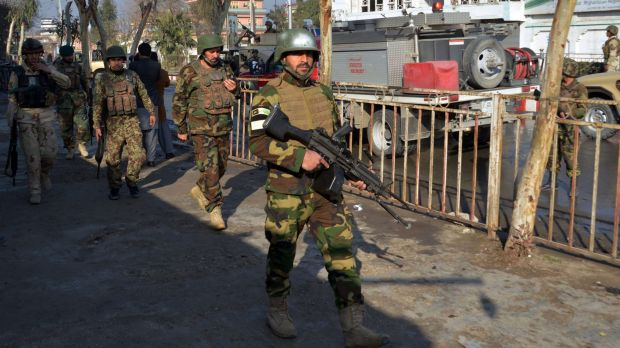 Afghan National Army soldiers take their positions at the clash site near Pakistan's consulate in Jalalabad, Afghanistan.