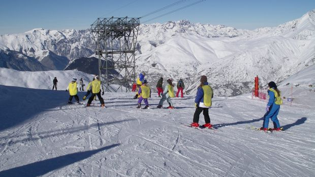 A ski school goes down a slope at Les Deux Alpes in the French Alps. An avalanche hit a group of school children on the ...