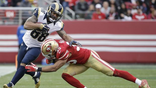 Rams tight end Lance Kendricks (88) is tackled by San Francisco 49ers safety Eric Reid (35) during one of the final ...