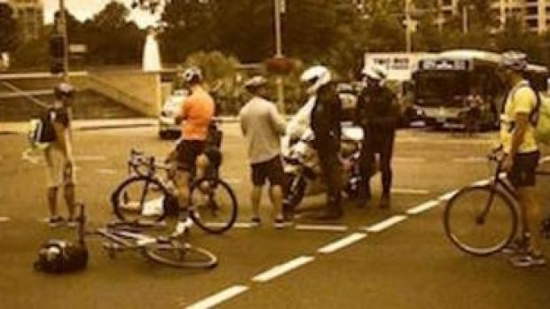 A witness claims the police motorcyclist pushed the cyclist off his bike.