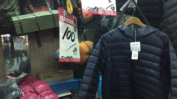 Oone stall has a Uniqlo down jacket for just 100 yuan ($21.60), some five times below recommended retail. Upon closer ...