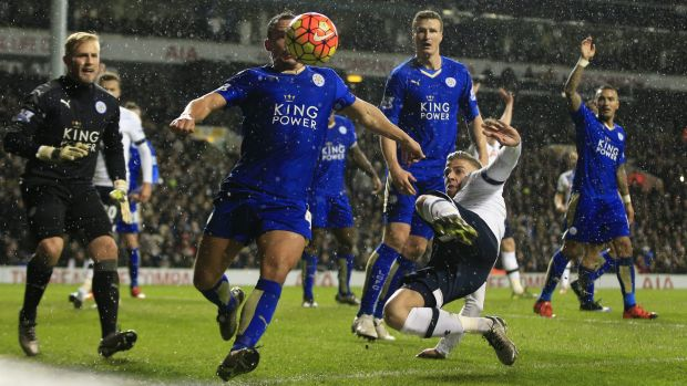 Leicester City's Danny Drinkwater moves to clear the ball under pressure from Tottenham Hotspur's Toby Alderweireld.