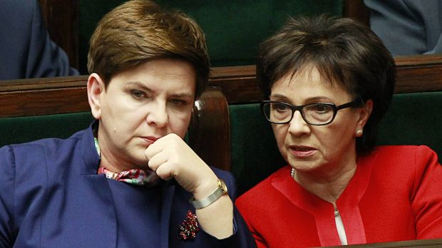 Polish Prime Minister Beata Szydlo,left, listens to a debate in the Parliament next to prominent member of the ruling ...