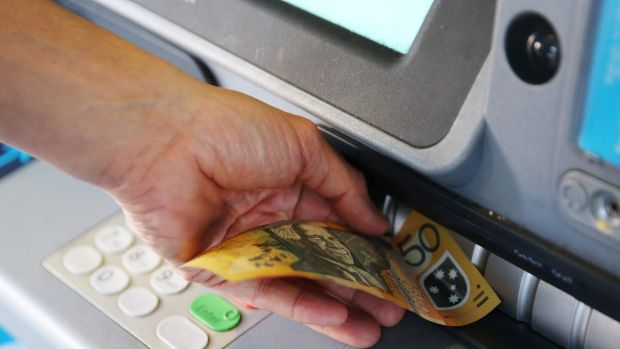 Cash withdrawals from ATMs were down 5.2 per cent in the pre-Christmas rush as credit card spending rose markedly .