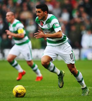Celtic are keen to extend the contract of Socceroos midfielder Tom Rogic despite interest from Leeds United.